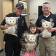 Officer Scott Gardiner and Chief Tracy Wyant thank Savanna Fitzgerald for her donation. (Sara Fitzgerald)