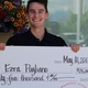 Ezra Pugliano smiles while holding the giant $25,000 scholarship check Chick-fil-A granted him on May 10. The sophomore financial advising major at Utah Valley University was selected as a scholarship recipient out ofthousands of applicants. (Tori La Rue/City Journals)