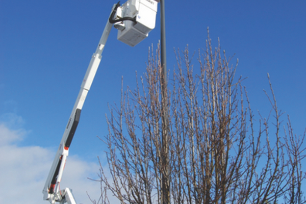 West Jordan Public Works employees swap traditional streetlights with LED lights during the summer of 2016. The city recently received a $240,000 rebate check from Rocky Mountain Power for this project. (West Jordan City)