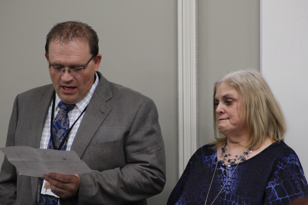 Pamela Spitzer holds back tears as Fort Herriman Middle School Principal Rodney Shaw reads aloud a note a former student wrote about her. Spitzer and 22 other teachers were honored at the Southwest Valley Chamber of Commerce's Annual Teacher Appreciation Lunch. (Tori La Rue/City Journals)