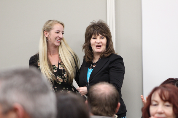 Kelsey Jacobson chuckles during the Southwest Valley Chamber of Commerce's packed Teacher Appreciation Luncheon at Riverton Hospital while Herriman Elementary Principal Kim Gibson describes why Jacobson was selected as Teacher of the Year. (Tori La Rue/City Journals)