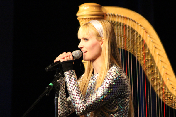 The Harp Twins often speak with the audience telling jokes and talking playfully about their experiences. (Travis Barton/City Journals)
