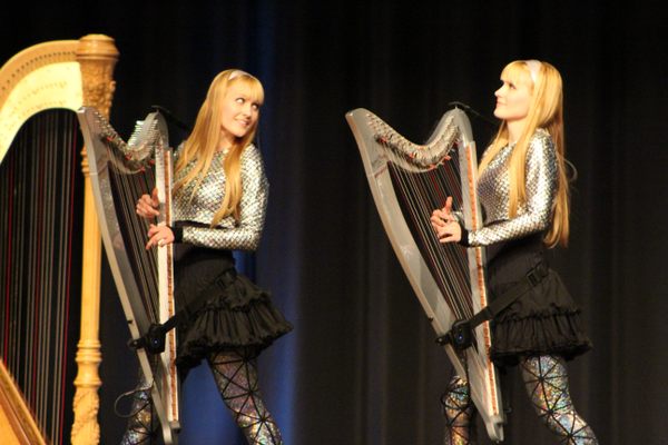 The rock harp duo, Camille and Kennerly Witt, play both covers and original songs on their grand concert and electric harps. (Travis Barton/City Journals)