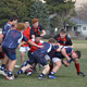 Zach Lowry gains ground against Genesis in March with support from Carson Petty. Rocky Marks, left, Anthony Suarez, and Bubba Anfinson follow closely. (Duard Peterson/ Brighton Rugby)