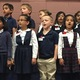 American Preparatory Academy students sing, paying tribute to fallen soldiers during the school's annual Memorial Day assembly. (Julie Slama/City Journals)