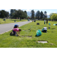 Members of the Fair Oaks YSA Stake help to clean up around the gravestones at the Sandy Cemetery. (Keyra Kristoffersen/City Journals)