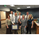Alan Rae, holding two certificates, poses for a picture with his family, Herriman administrators and city council members after being honored at a May 10 meeting. (Herriman City)