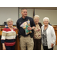 Betsy Jones and Nancy Strader donated more than 100 stuffed animals to Mayor JoAnn Seghini and Police Chief Jason Mazuran during a city council meeting. (Ruth Hendricks/City Journals)