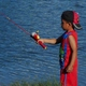 Young anglers enjoy an evening of education, baiting hooks and casting at Willow Pond. (Carl Fauver)