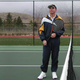John poses with his racket on the tennis court in February of 2004. (Valerie Leavitt)