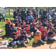 The baseball players, parents and board members celebrated the unveiling of a new memorial to honor fallen officers at Ron Wood Baseball Complex. (Greg James/City Journals)
