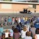 A kindergarten class performs during the school's annual dance festival. (Travis Barton/City Journals)