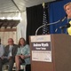 Cecily Tynan introduces Wyeth and other guests at the stamp dedication.