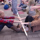 Marley Rodney and Kennedy Jacobs learn the stick pull at Butler Elementary's fourth-grade Mountain Man Rendezvous. (Julie Slama/City Journals)