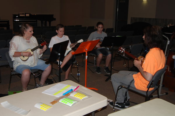 Attendees had the opportunity to participate in a free ukulele class taught by Riverton Music employees. (Keyra Kristoffersen/City Journals)