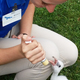 Jessica Schombert, assistant aviculturist, feeds one of five babies hatched at the aviary.