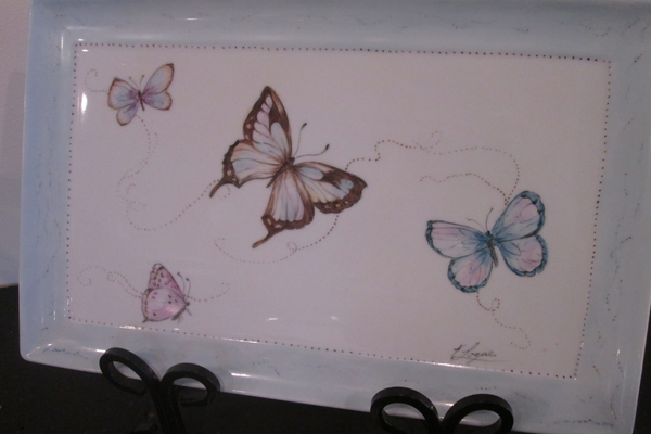A painted ceramic tray by Kathleen Logue.