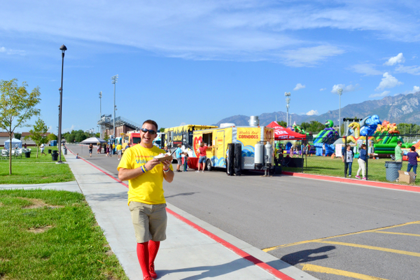 Tim Provost, a volunteer at the I Am Draper City service project, enjoying the food trucks, all of which donated part of their profits to the service project. (Lexi Peery/City Journals)