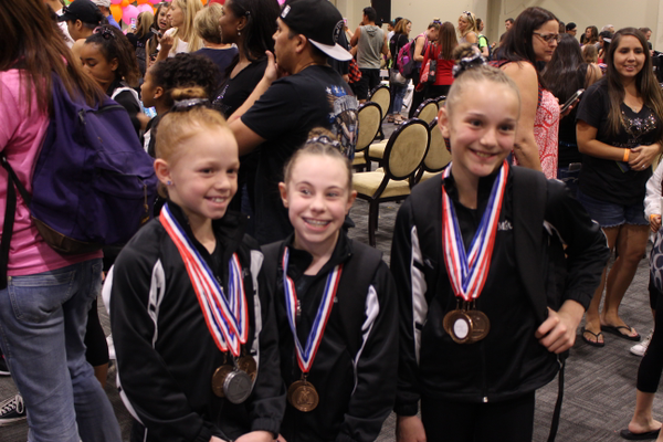 (From left to right) Hayli Westerlind, Nya Samora and Monet Ward recorded some of the highest scores at the Utah Stat Gymnastics Championships in March. (Rune Westerlind)