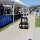 A remote-controlled toy police car named Cuffs drove around the booths and talked to kids about the event. (Jessica Parcell/City Journals)