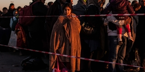 Medium refugees waiting at austria hungary border photo credit