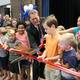 Board of Education member Steve Wrigley, a former resident of the Alta View neighborhood, helps to cut the ribbon to officially open the new Alta View Elementary. (Jeff Haney/Canyons School District)