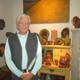 Dave Eldreth in the Eldreth Pottery store with one of his paintings and some of the companys traditional stoneware and redware
