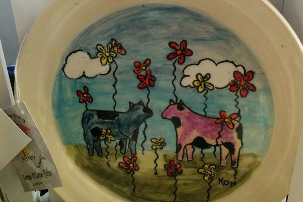 Karen O'Lone-Hahn has a line of painted dishes using her distinctive designs