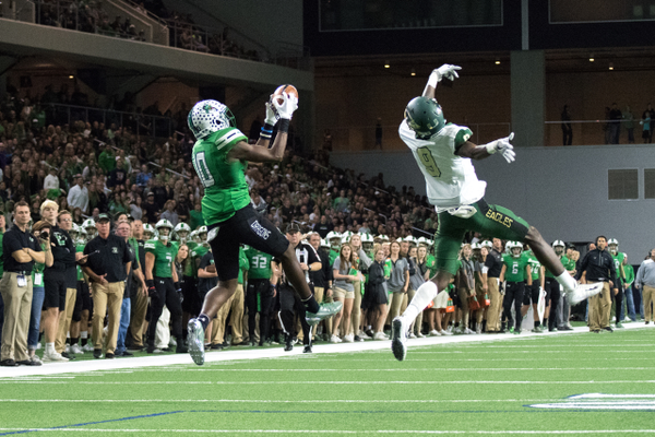 Nov. 25 - RJ Mickens catches a Will Bowers pass during a 33-15 win over the DeSoto Eagles in the Area round of the 2017 UIL Playoffs at the Ford Center in Frisco, TX. Photo by S.Johnson/SnappedDragons.com