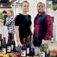 Caroline Kelley & Kenny Patel of Field's Wine & Spirits offer wine samples