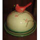 A cardinal-topped serving dish by Amy Burk.