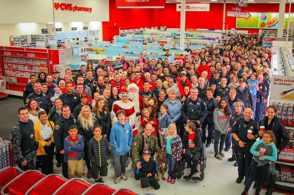 Shop with a cop december group photo inside target crop