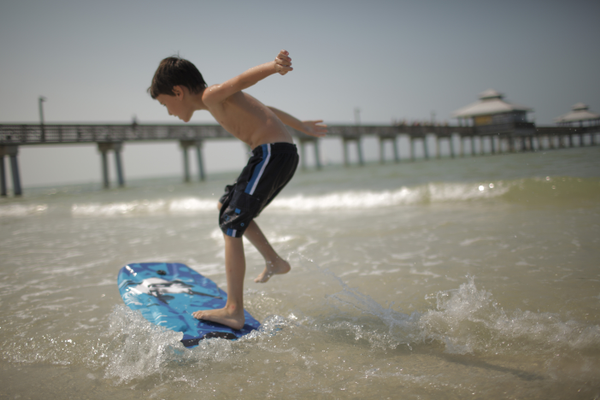 No boredom allowed on Fort Myers Beach— stand-up paddleboarding, fishing off the pier, skimboarding, and just playing in the sand are all part of the local activities. Photo courtesy of Lee County VCB.
