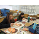 Hillcrest High School art students paint portraits of Syrian refugee orphans and through Memory Project, the children received the personal keepsakes. (Kari Bennett/Hillcrest High School)