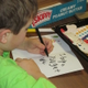 A student makes a card at Hillendale Elementary.