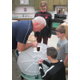 One of the teams assembles a Tower Garden at Patton Middle School, with some advice from Duane McCarthy.