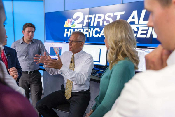 The senior meteorologist leads a discussion with cast and crew as Irma approaches. Photo courtesy of NBC2.
