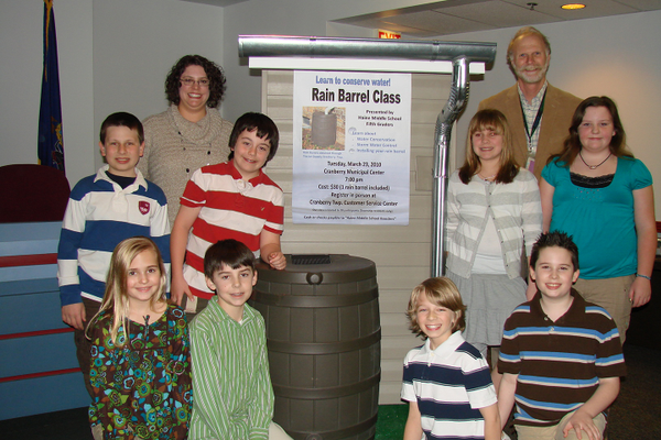 Teacher Allison Stebbins, Lorin Meeder, engineering and environmental services coordinator for Cranberry Township, and some of the student rain makers.