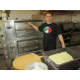 Brian Clossen has been enjoying more than 15 minutes of fame for his custom-made pizzas at the Little Italy Pizzeria in Townsend