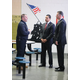 Massachusetts Department of Veterans' Services Secretary Francisco A. Ureña (center) and Middlesex Sheriff Peter J. Koutoujian (right) speak with MSO Veteran Services Coordinator Paul Connor.