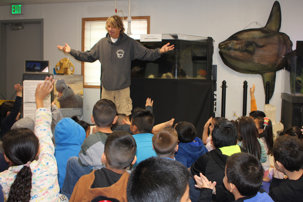 Aquarist Eric Martin teachers a class in the aquarium's temporary facility