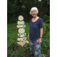 Artist Marijke van Buchem with her sun totem sculpture in her backyard garden She credits the Cecil County Arts Council as supporting her artwork by offering classes and groups throughout the year