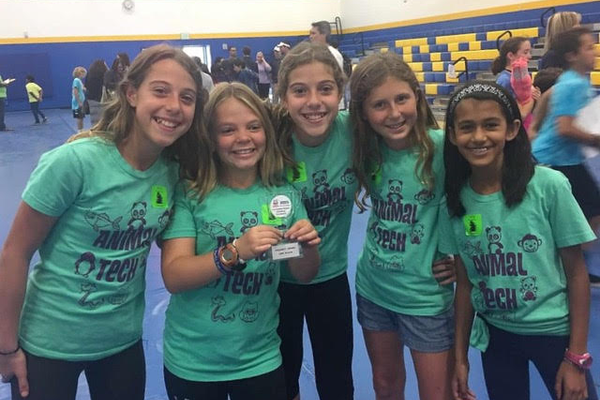 The Animal Tech team, from left to right: Sabrina Guidry, Ella Temperley (holding trophy), Julia Guidry, Lauren Vick, and Shivana Parekh