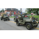 Military vehicles from past wars were driven in the parade.