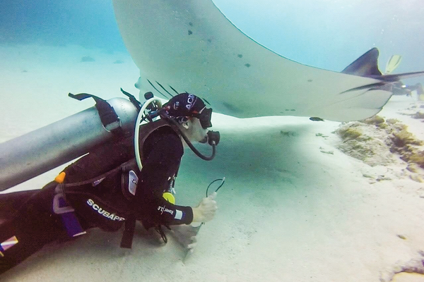 Dive Master Stephen Cunningham of Dive Komodo with Manta Ray.