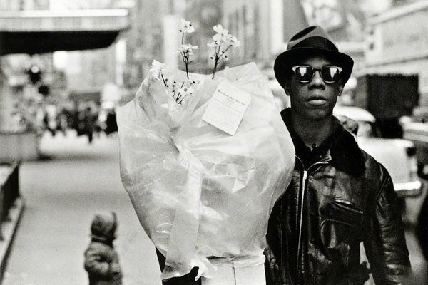 Frank Paulin, Flower Messenger, Times Square, 1955, printed later, gelatin silver print, 15 7/8 x 19 7/8 inches. Collection of the Palmer Museum of Art, Gift of Bruce and Silke Silverstein, 2015.145.©Frank Paulin Archive, Courtesy of Bruce Silverstein Gallery, New York.