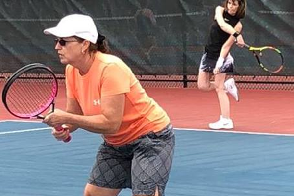 Tewksbury residents JoAnn Velozo and Sharon Foreman compete in Women's Doubles on Friday 6/22 the opening evening of the tournament.