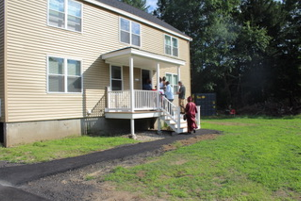 Lowell Habitat for Humanity and Tewksbury Habitat Build dedicated new homes for the Kato family and Abdulkarim family on South Street recently. (Kayleigh Ann Nagle Photo)