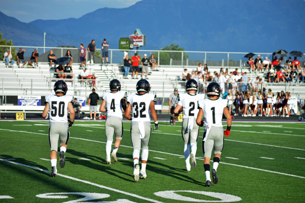 Alta's captains make their way onto the field for the coin toss.
