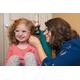 Dr Sarah Curtis examines 3-year-old Ava Hersman with an otoscope